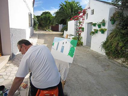 Uno de los artistas que ayer pintó al aire libre paisajes de Gilena. Foto: CMG.